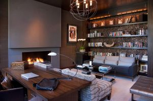 Stylish-home-office-with-plenty-of-shelf-space-and-a-chic-fireplace